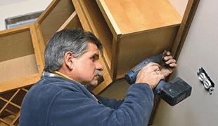 Работы по монтажу шкафчиков на стену из гипсокартона.